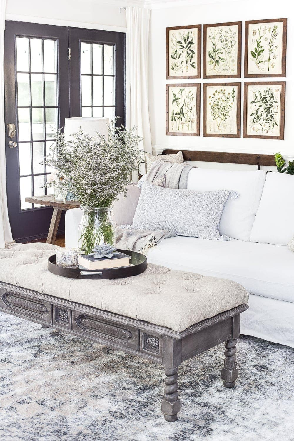 summer living room featuring summer botanical prints and blue/gray accents