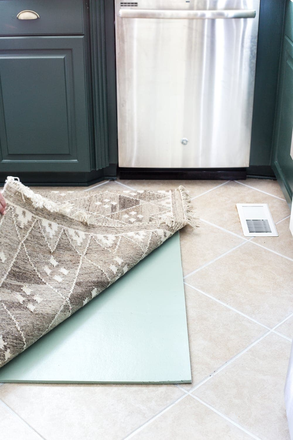 layered memory foam kitchen rug trick to add comfort on hard tile floors