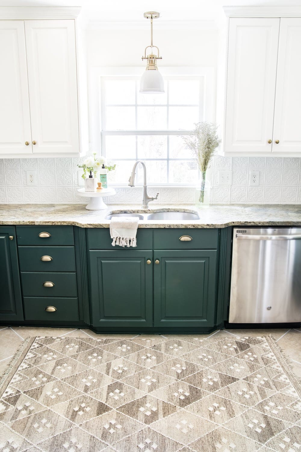deep green kitchen cabinets with DIY pressed tin ceiling tile backsplash and layered memory foam kitchen rug
