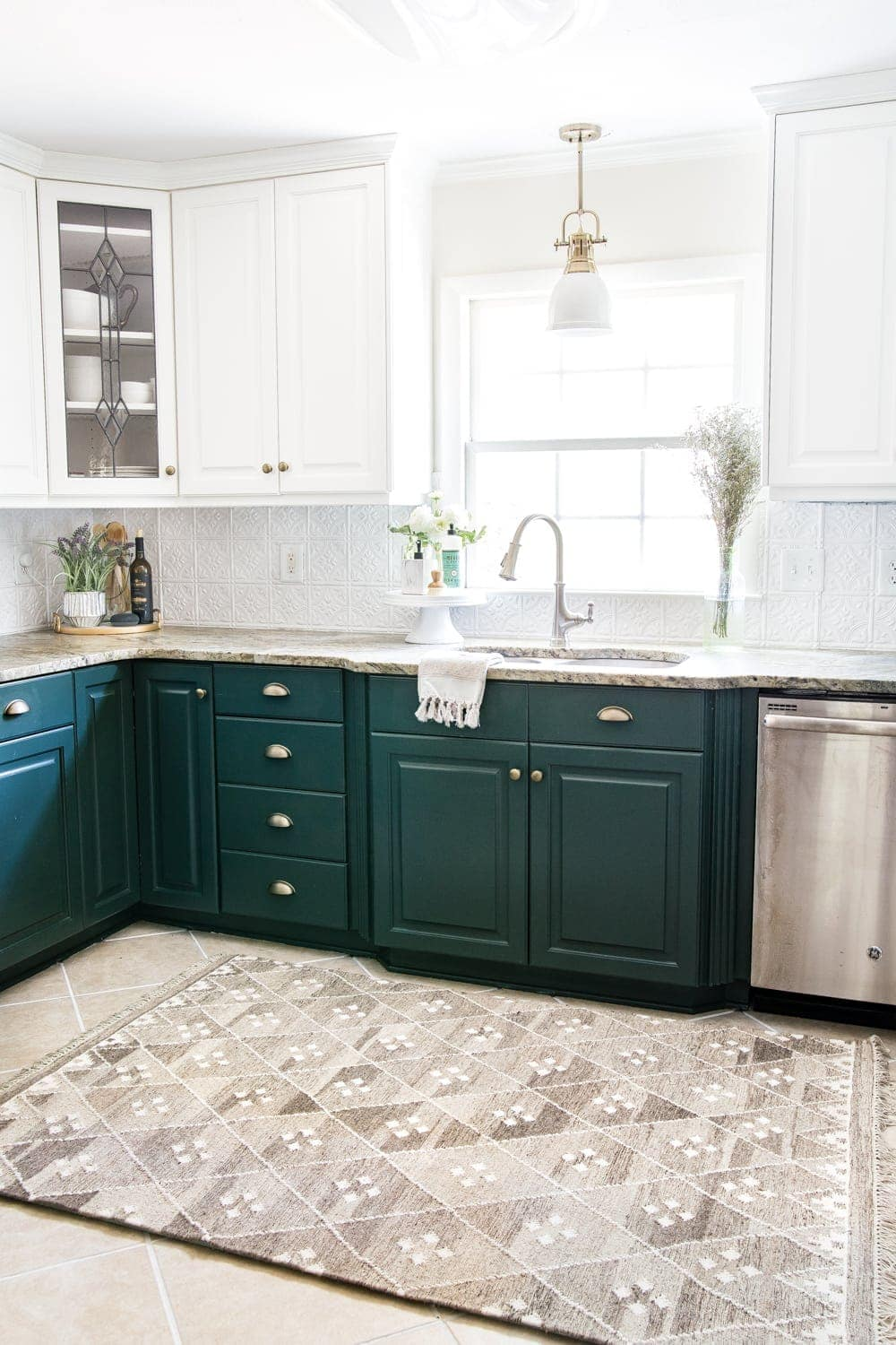 deep green kitchen with layered memory foam kitchen rug and pressed tin ceiling tile backsplash