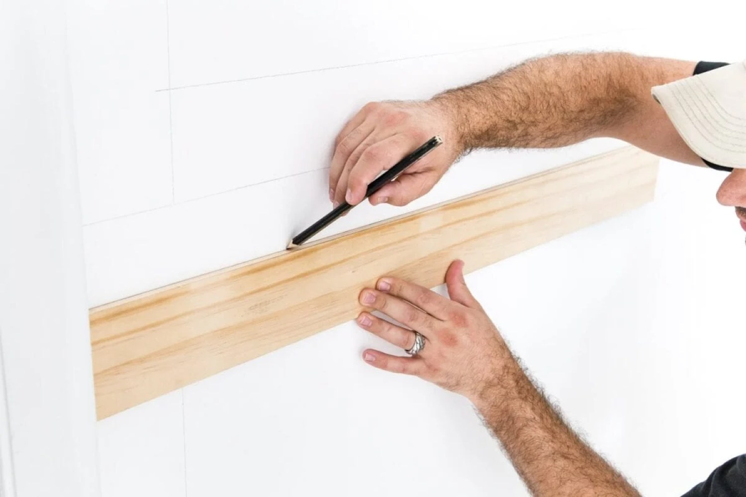 """Use a 3/8"""" x 4"""" board as a spacer to mark picture frame molding"""