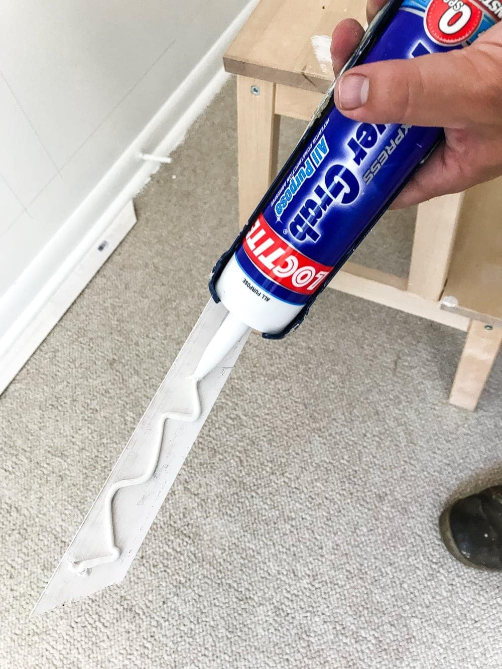 use construction adhesive to make attaching picture frame molding to walls easier