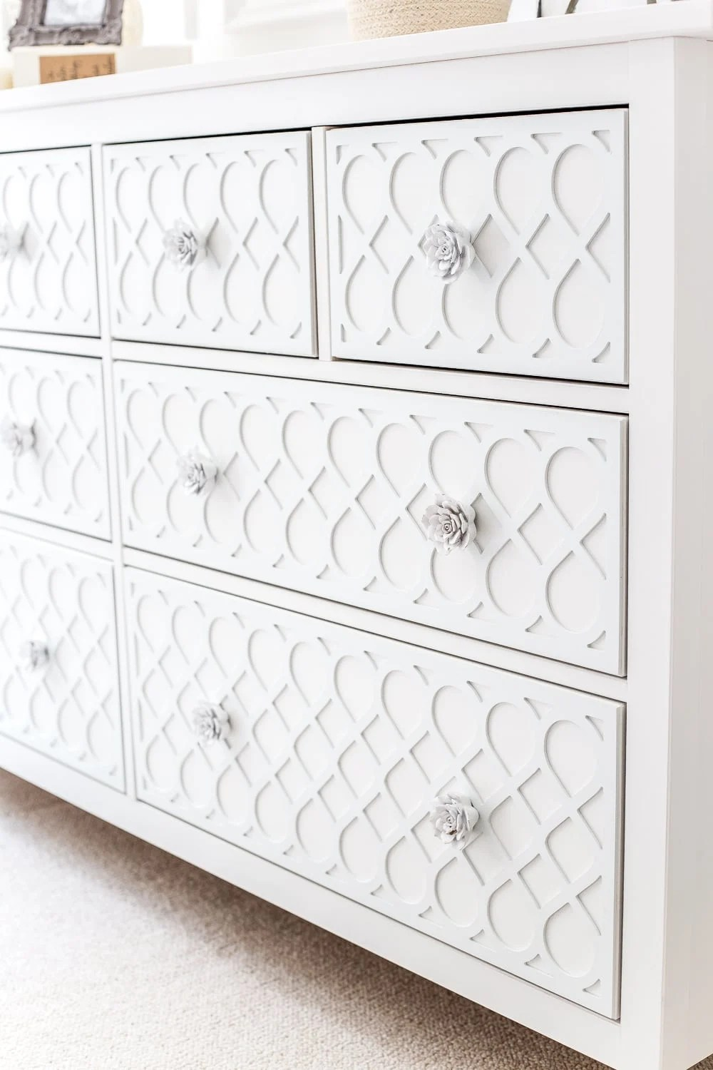 How to get a high-end carved detail look for less on a plain IKEA dresser using appliques. #IKEAhack #dresser #furnituremakeover
