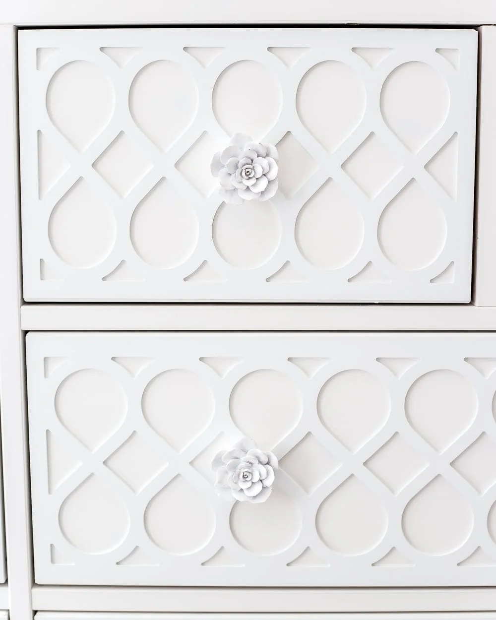 Dresser drawer details using feminine appliques and cactus flower knobs