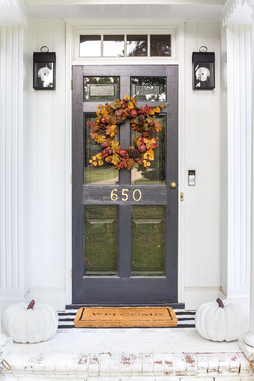 fall porch with white pumpkins and wreath