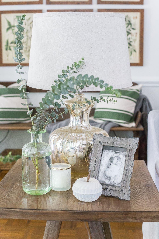 Neutral fall decor on an end table