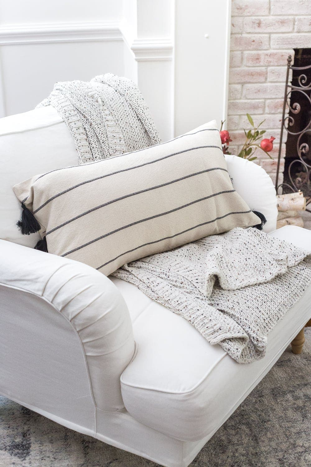 Neutral fall decor and cozy reading chair