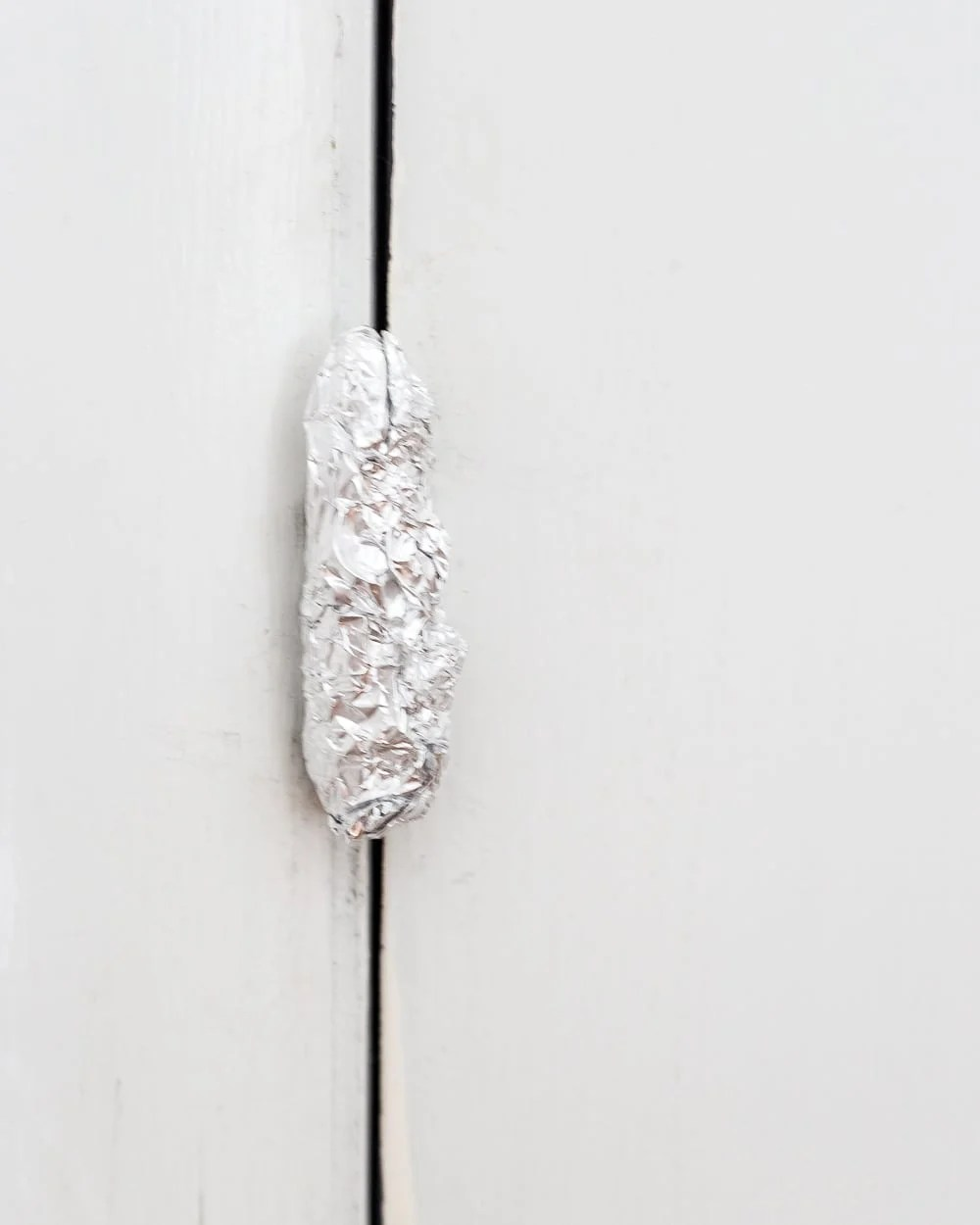 Tip: Use aluminum foil on hinges and doorknobs before painting doors