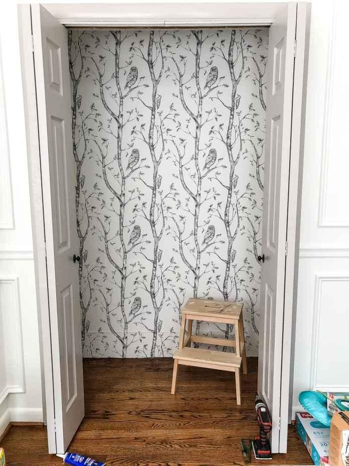 Nursery closet with peel and stick gray birch tree wallpaper