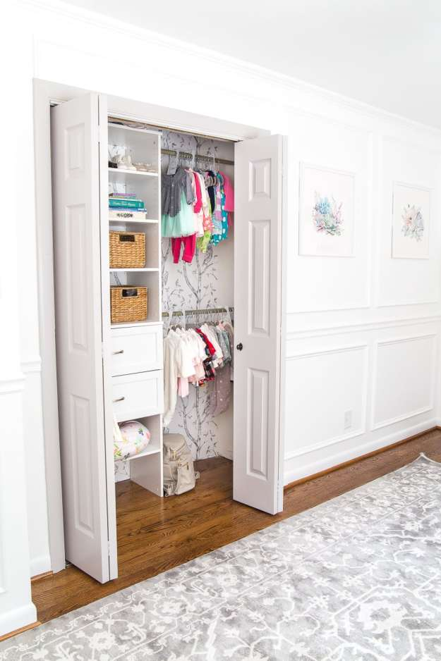 A full organizational overhaul on a nursery closet that is packed full of functional storage solutions for baby, plus a free closet divider printable set.