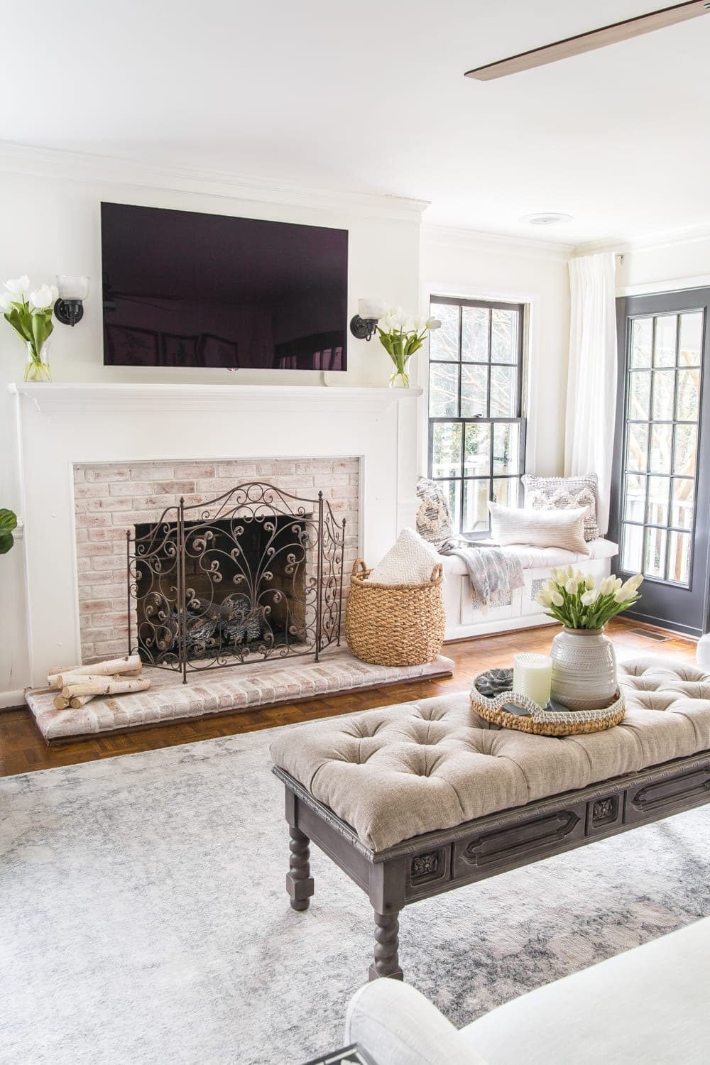 Simple Spring Home Tour | Neutral living room decorated with small floral touches for spring