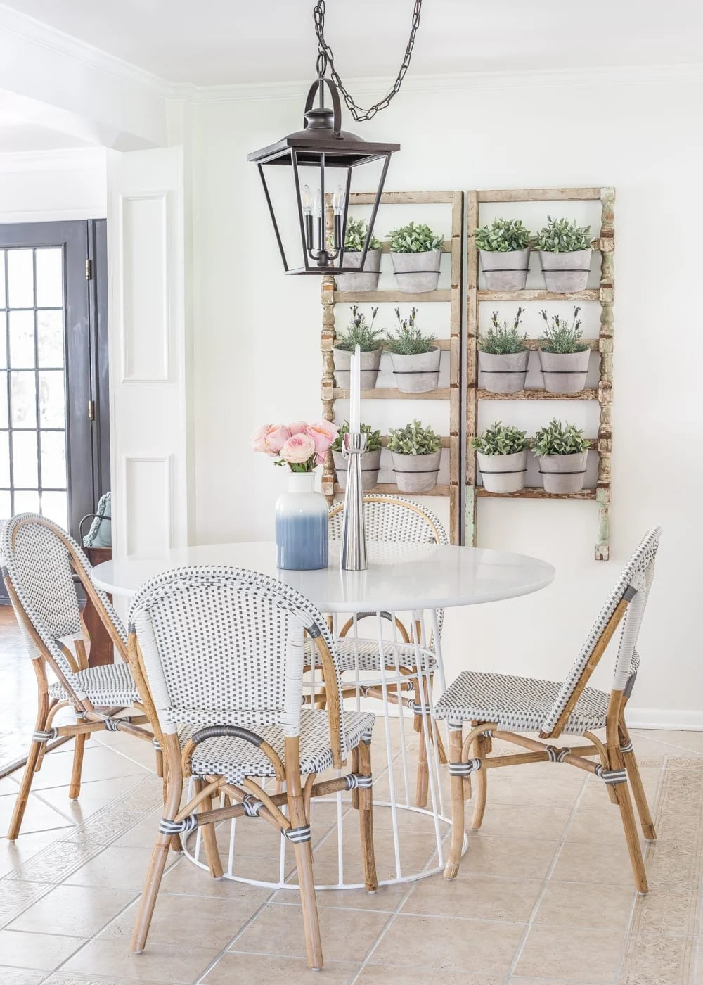 Simple Spring Home Tour | Breakfast nook informal dining with French bistro chairs and wall planter made from antique banisters