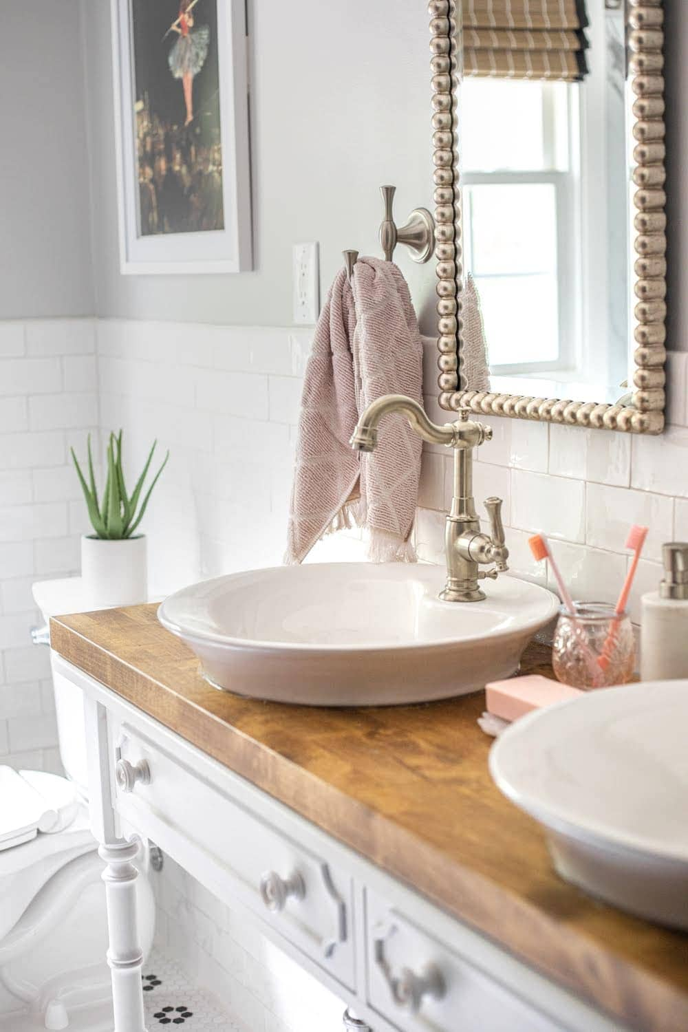 Whimsical, classic kids bathroom makeover | vessel sinks on a converted console table for a bathroom vanity