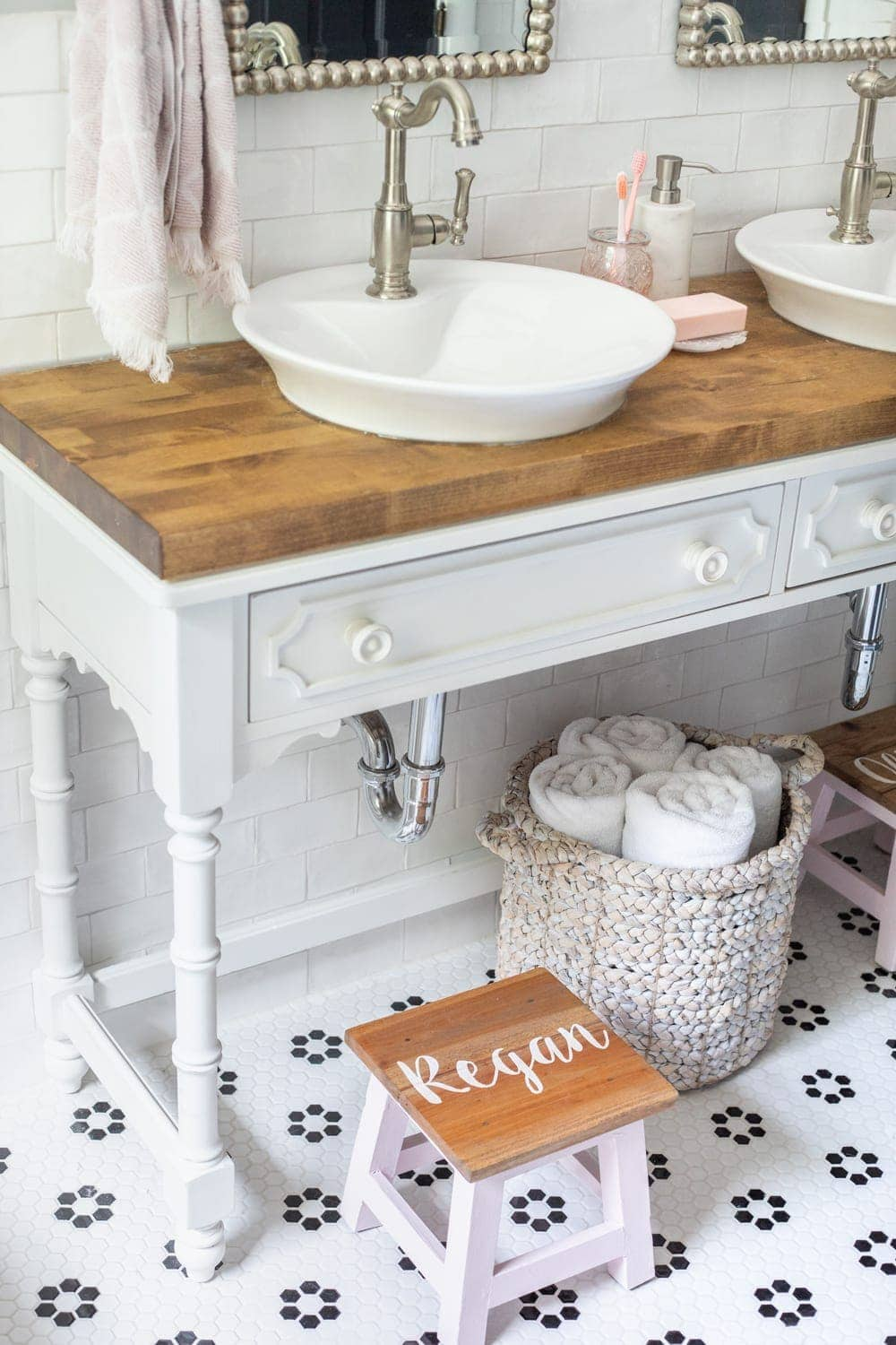 Girls' Bathroom Decor Details & Sources | Console table converted into a vanity with vessel sinks and personalized step stools