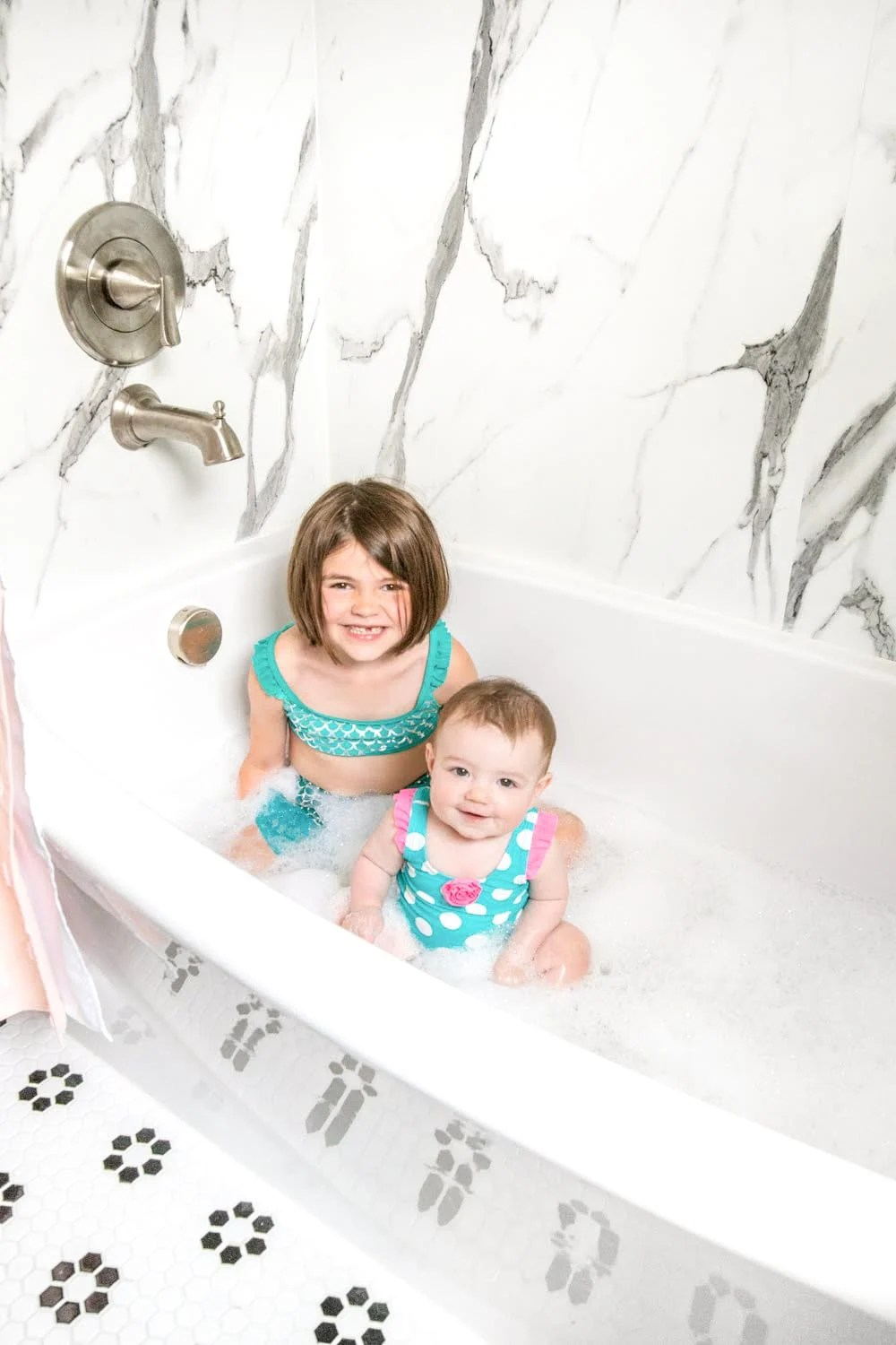 Whimsical, classic kids bathroom makeover   faux marble shower walls from American Standard