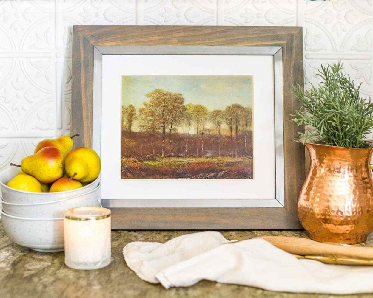 Access to a free autumn landscape art printable that you can print directly from your home printer and frame for budget-friendly fall decor.