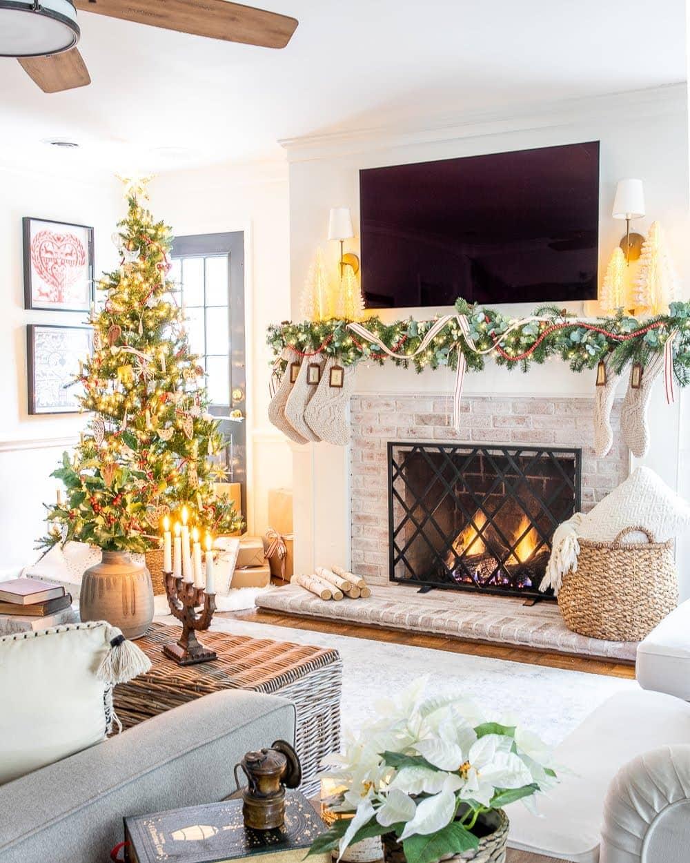 Christmas decor ideas | vintage modern living room mantel with TV and Christmas tree