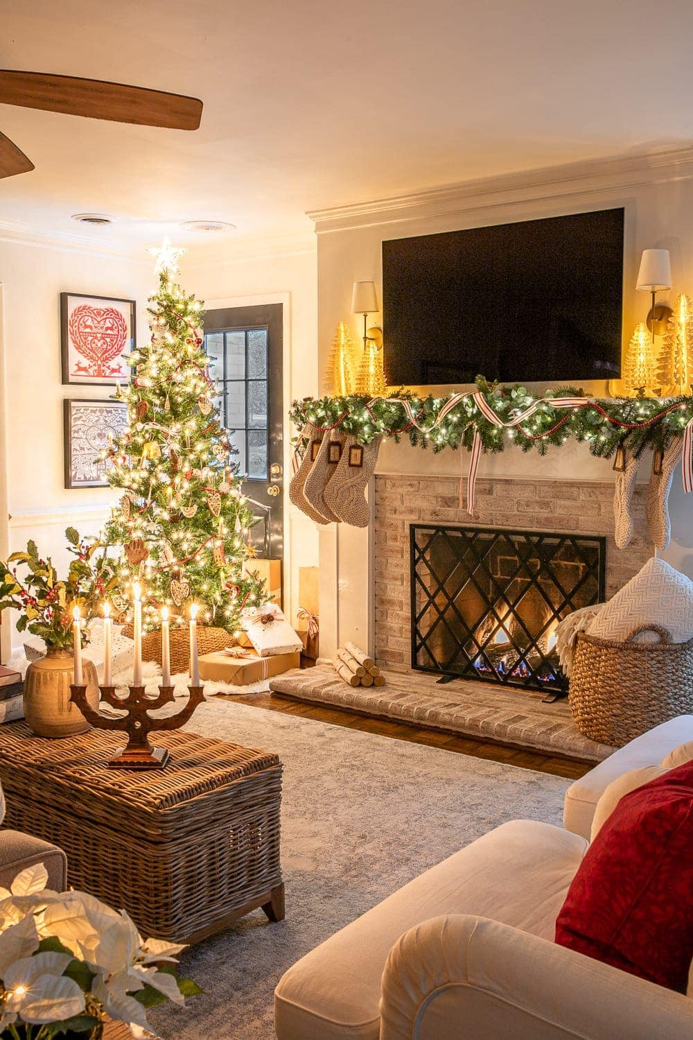 Christmas living room at night with fireplace and tree