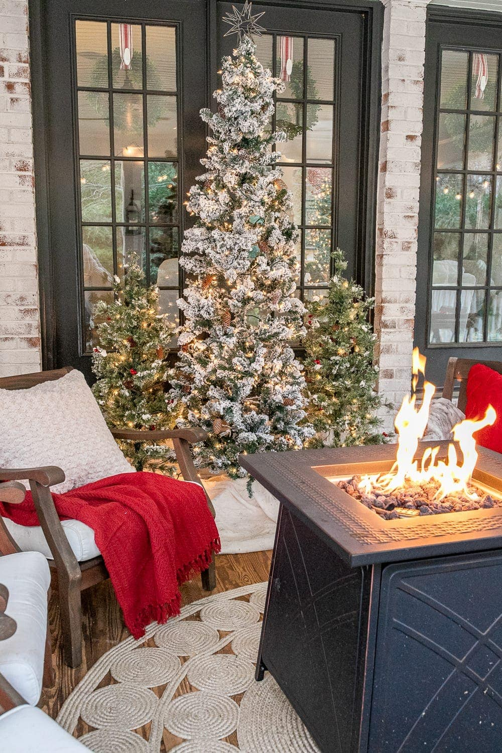 Back porch fire pit table and Christmas trees