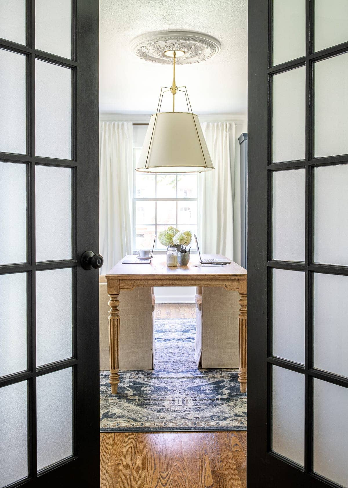 home office with French doors and frosted glass