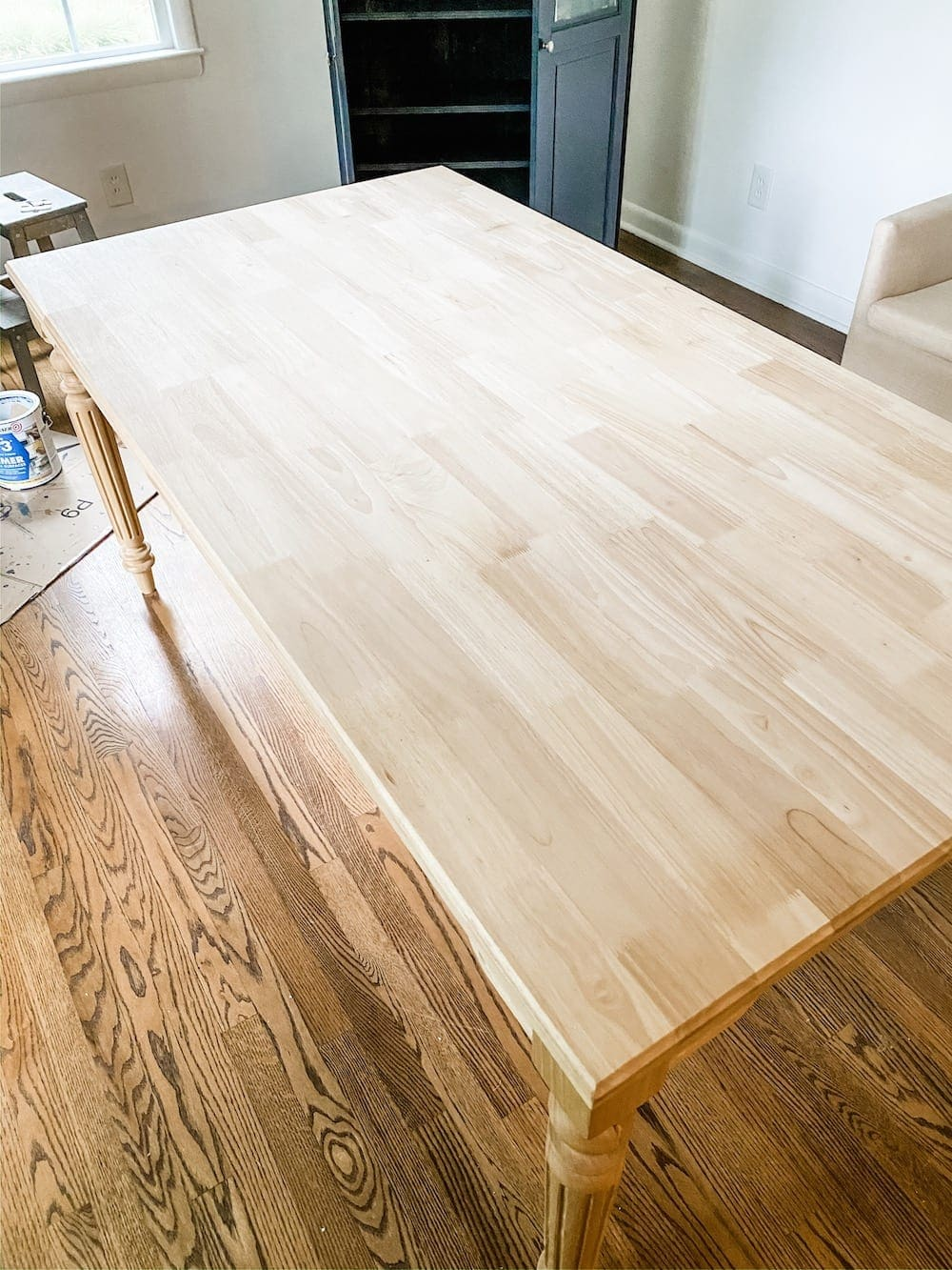 A budget-friendly option for customizing furniture to work in any space using unfinished, solid wood pre-built pieces & staining an office work table.
