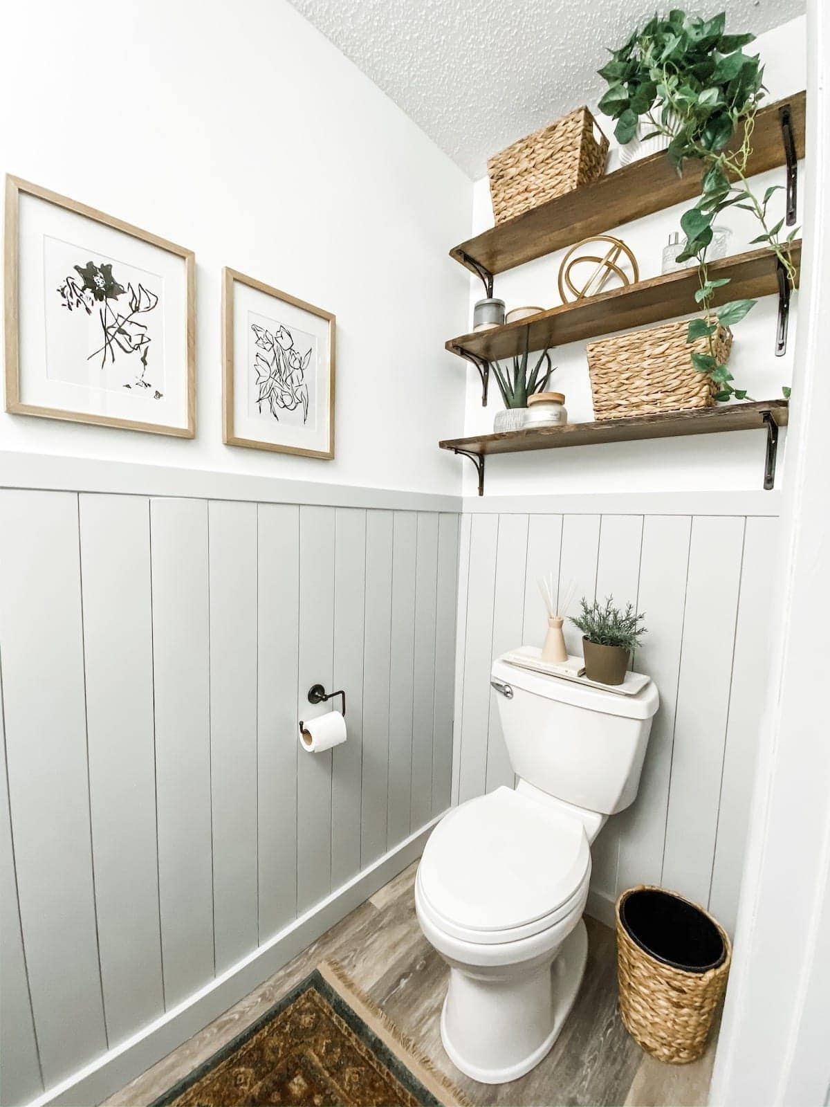 bathroom shelving above toilet with plants and decor