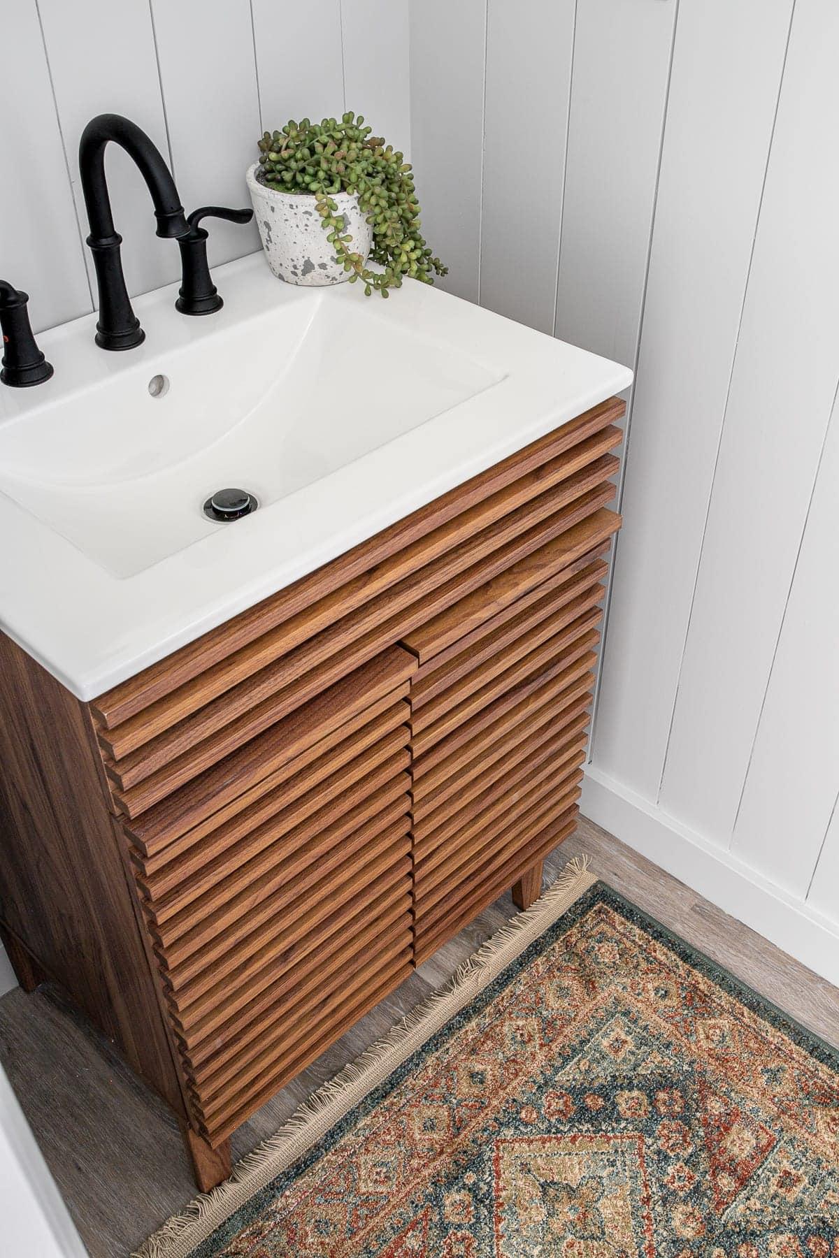 Mid Century Modern sink vanity and vintage style rug