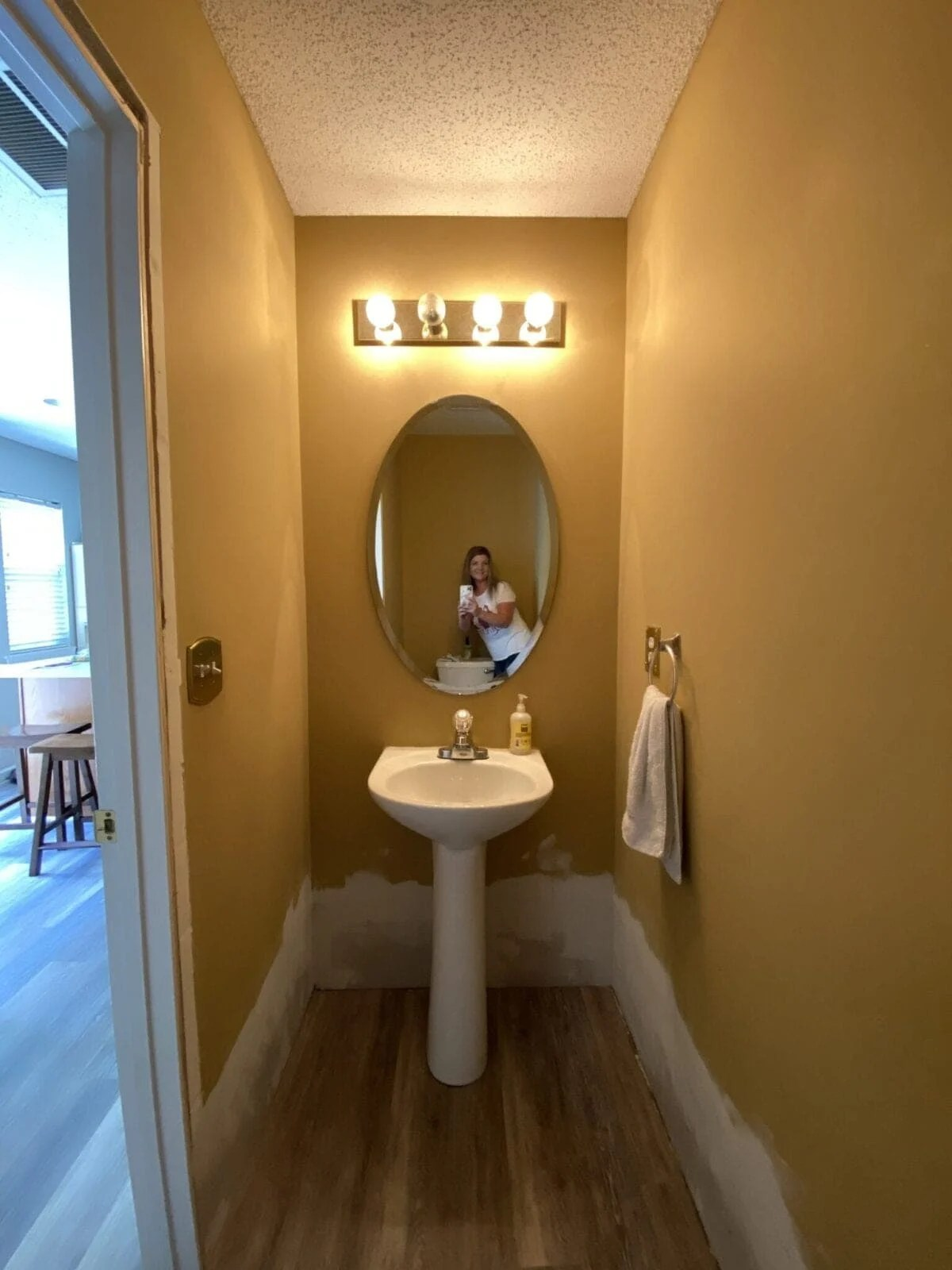 before powder room with gold walls