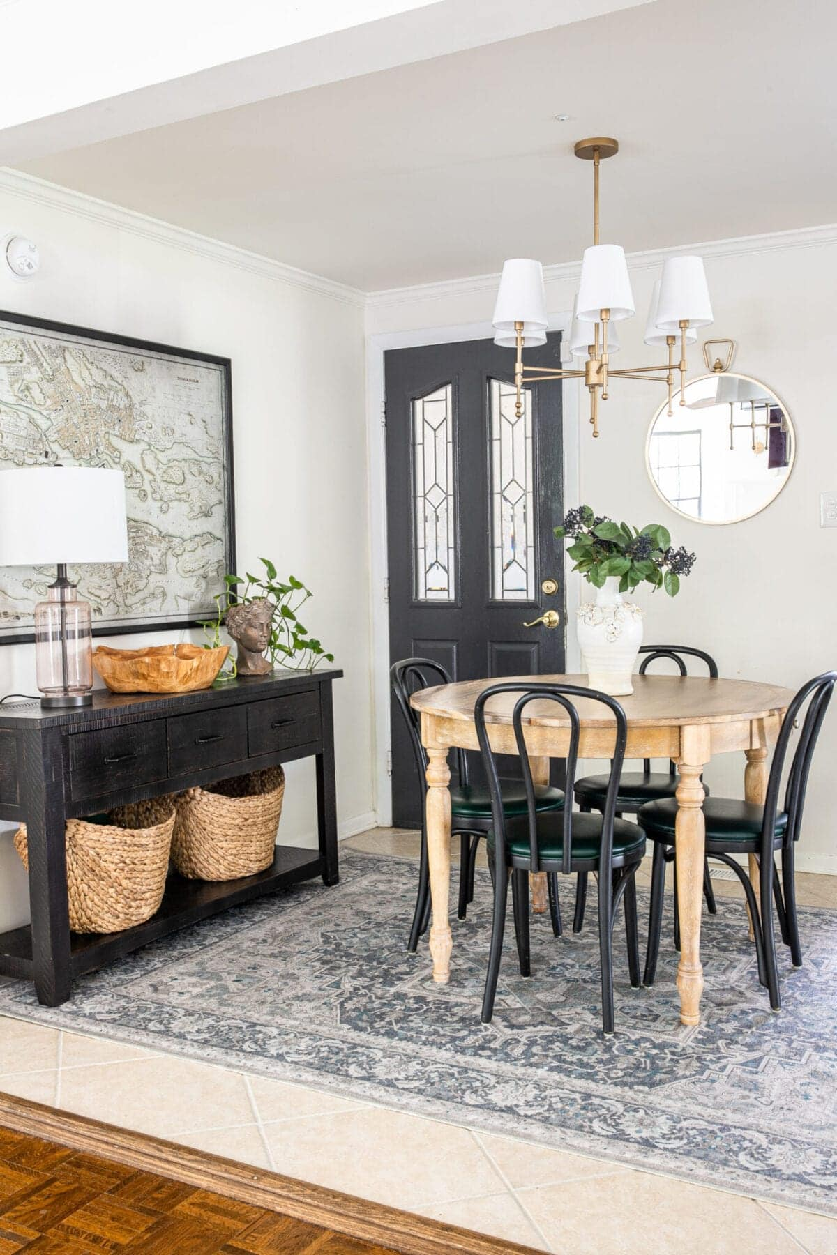Ruggable rug in dining room with console table and shaded chandelier