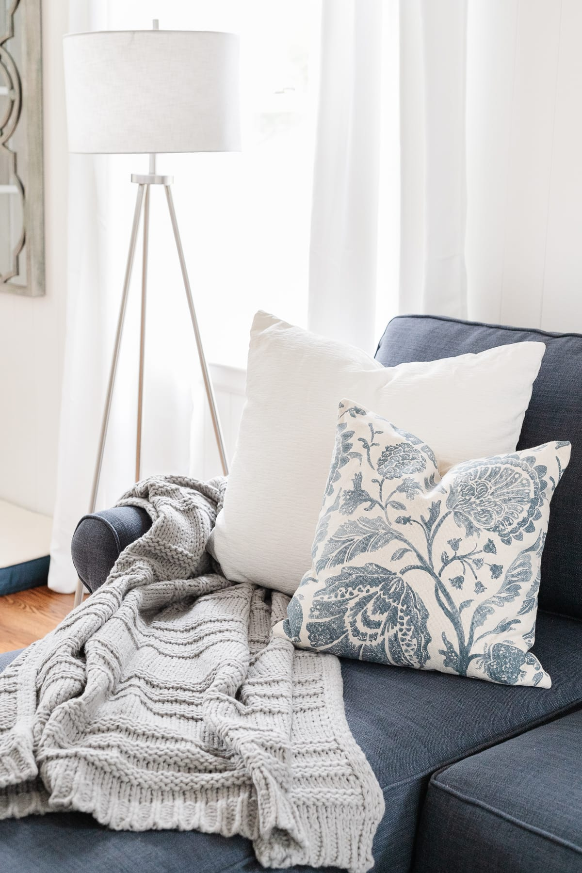 coastal style living room sofa with throw pillows