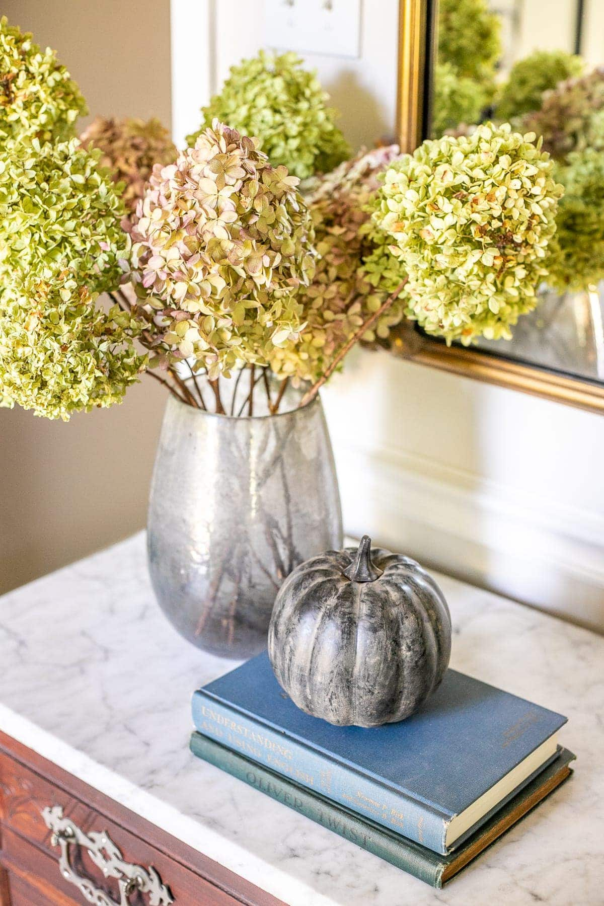 painted pumpkin with dried hydrangeas