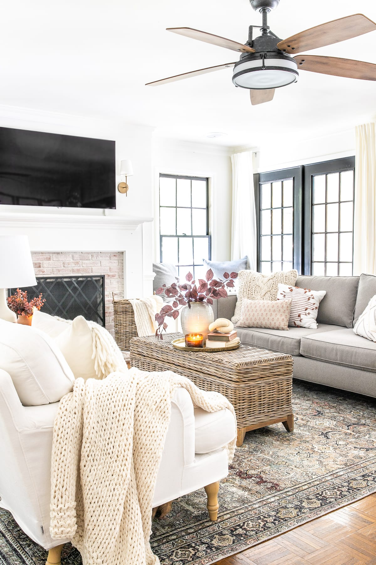fall living room with fall leaves and vintage style rug