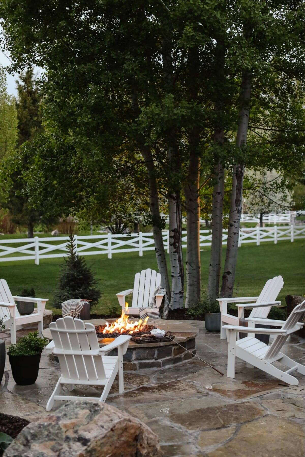 backyard fire pit with adirondack chairs