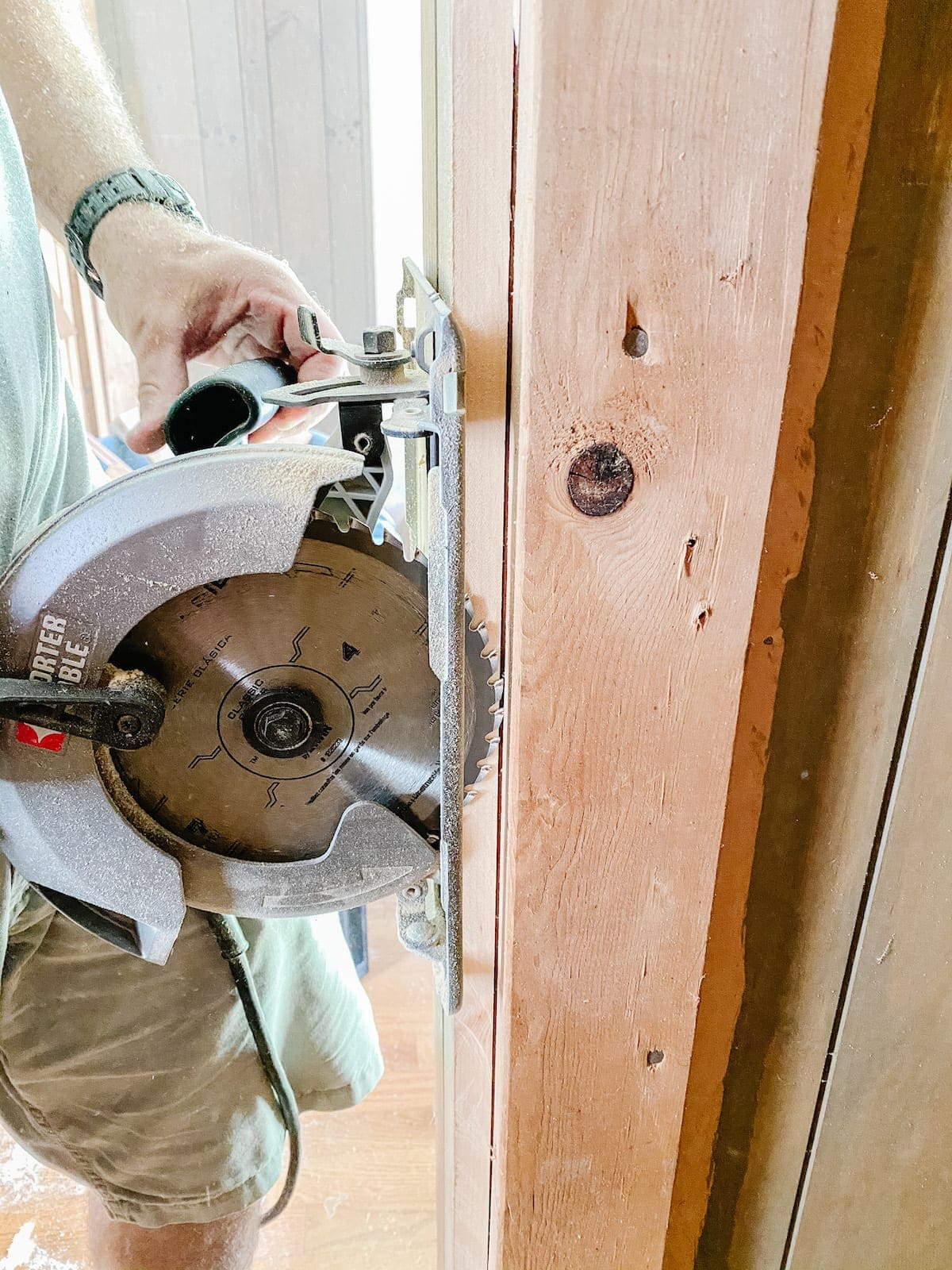 circular saw cutting closets open for built-in shelving