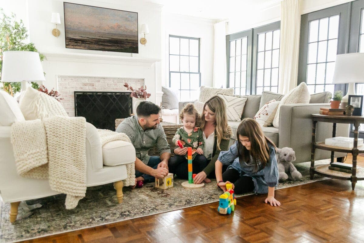 family playing together with toys in living room
