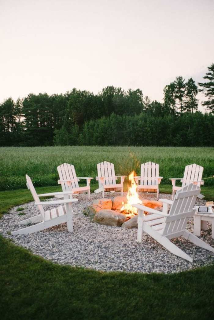simple fire pit idea with gravel and adirondack chairs