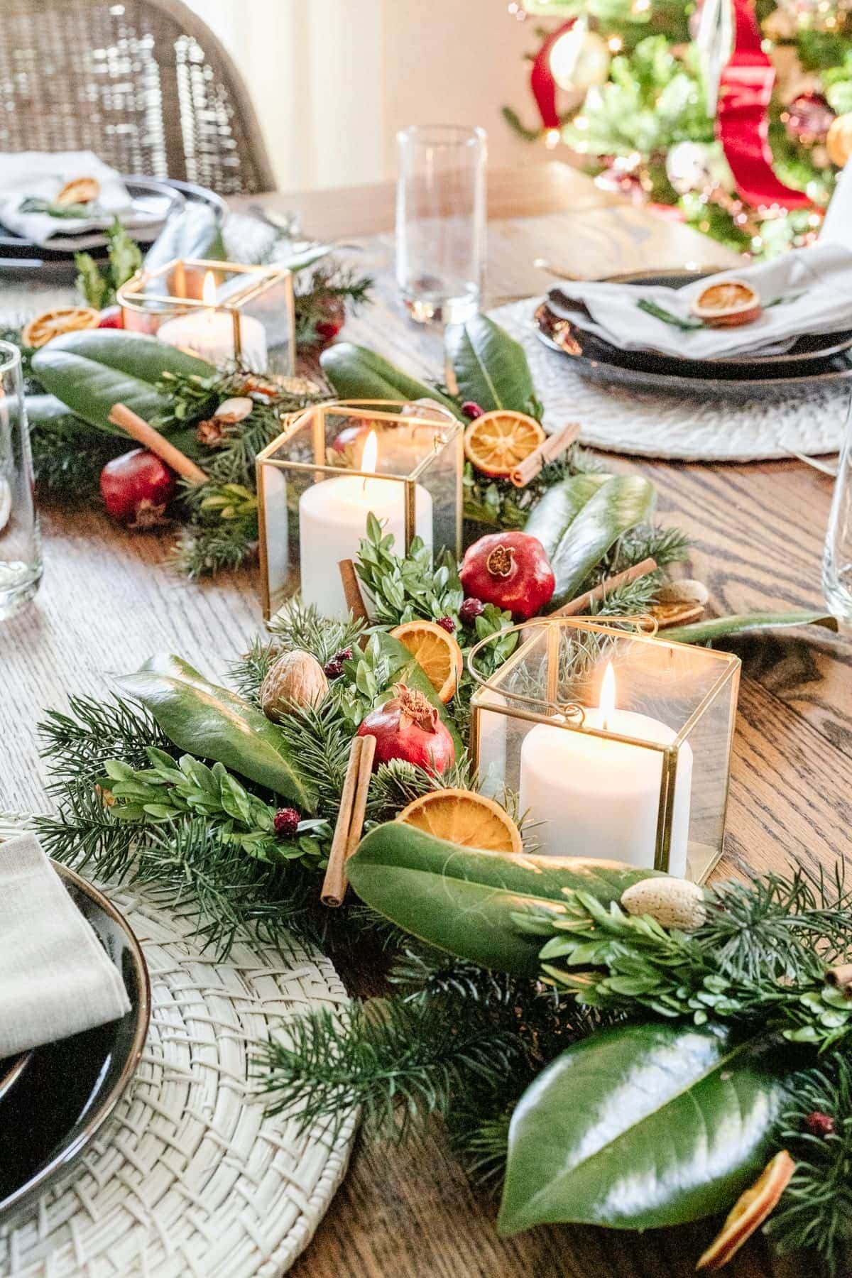 Christmas table centerpiece with candles and garland