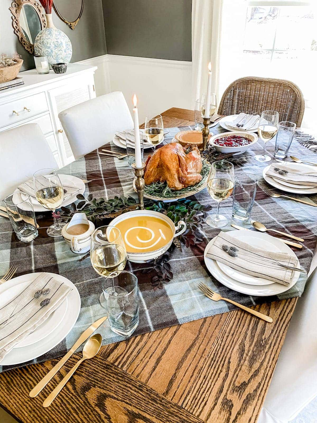 Use a throw blanket as Thanksgiving table decor