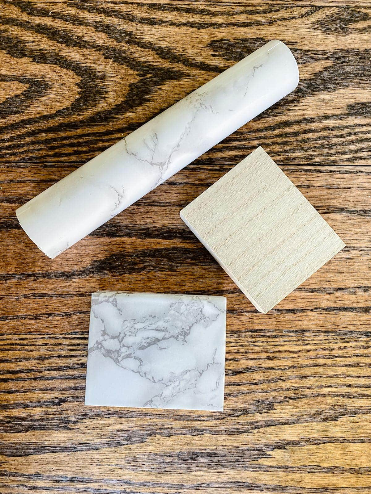 scrap wood block wrapped in marble contact paper