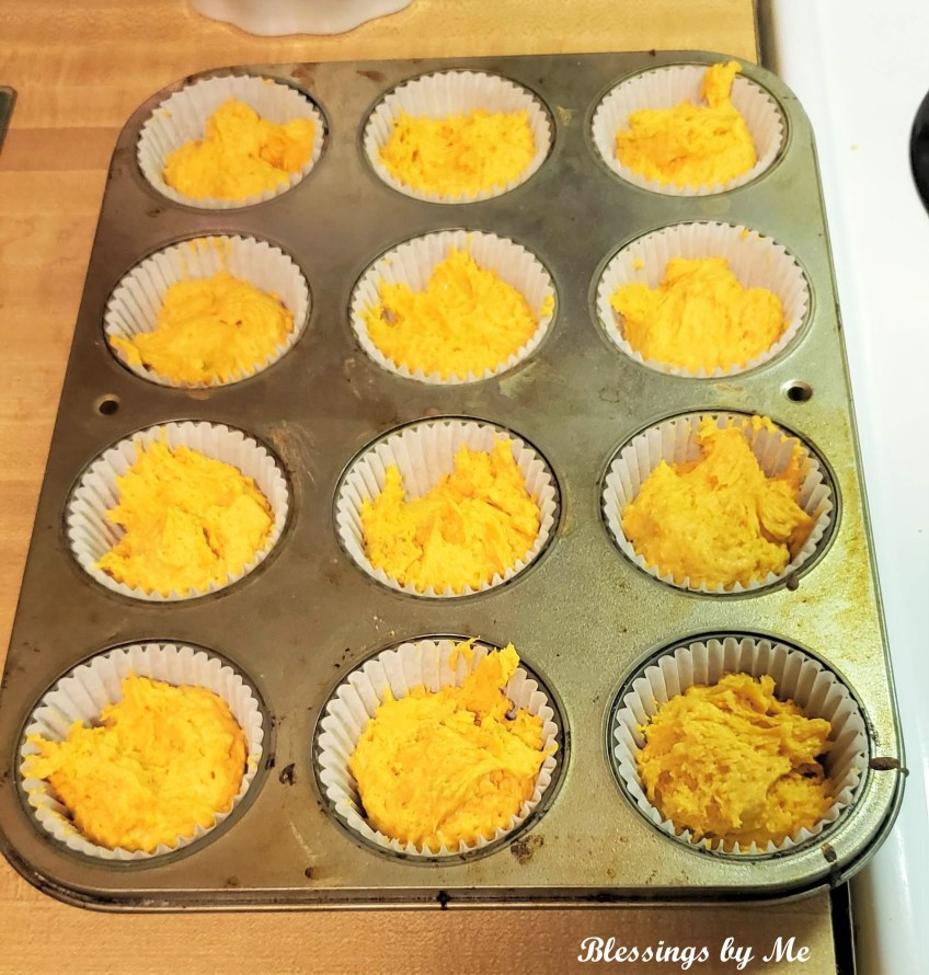 Pour pumpkin muffin mix into muffin tins lined with cupcake liners