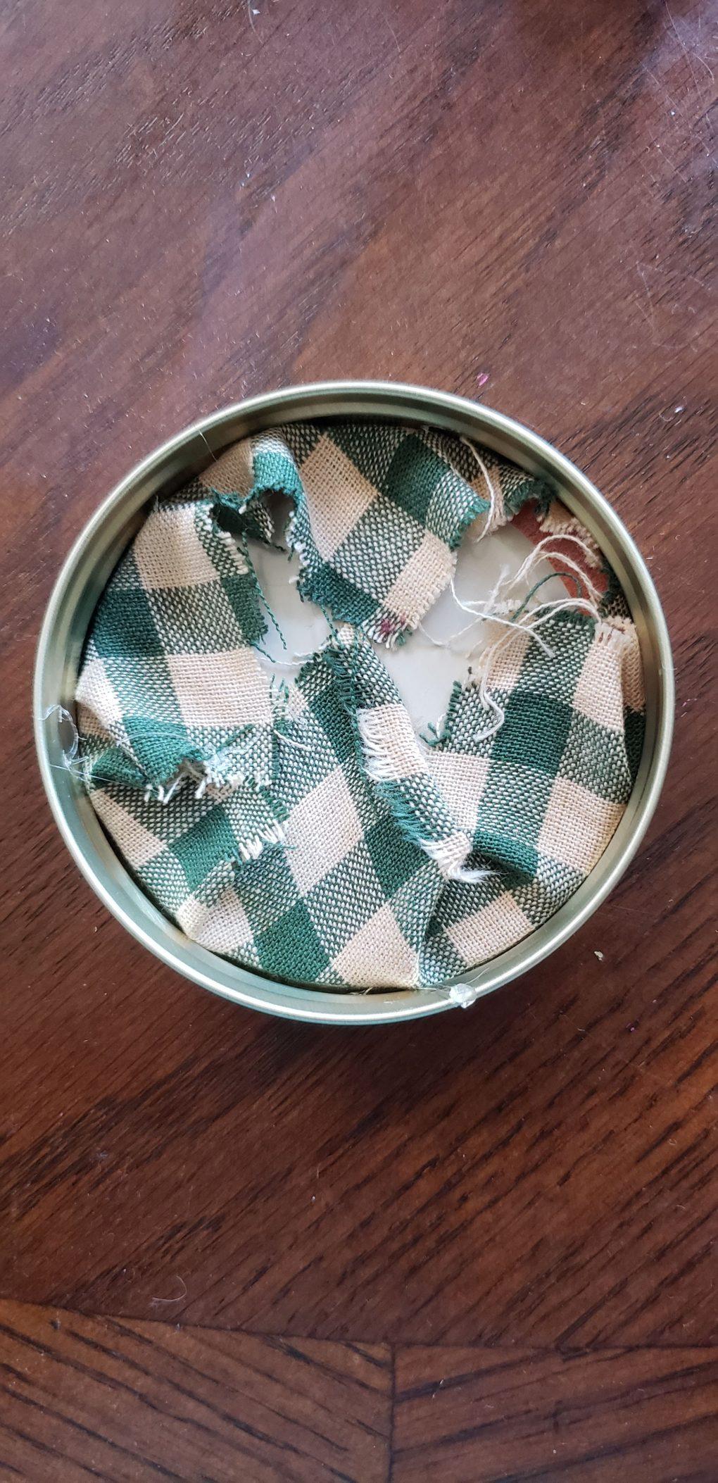 step2 - fold the fabric over the mason jar lid and glue