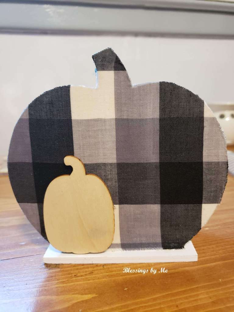 Add a wood pumpkin sticker to the fabric side