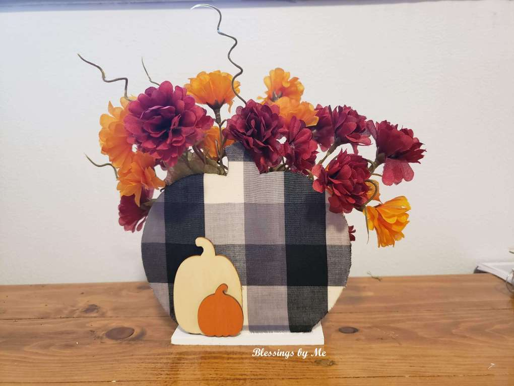 Add flowers to the 2-in-1 pumpkin decor
