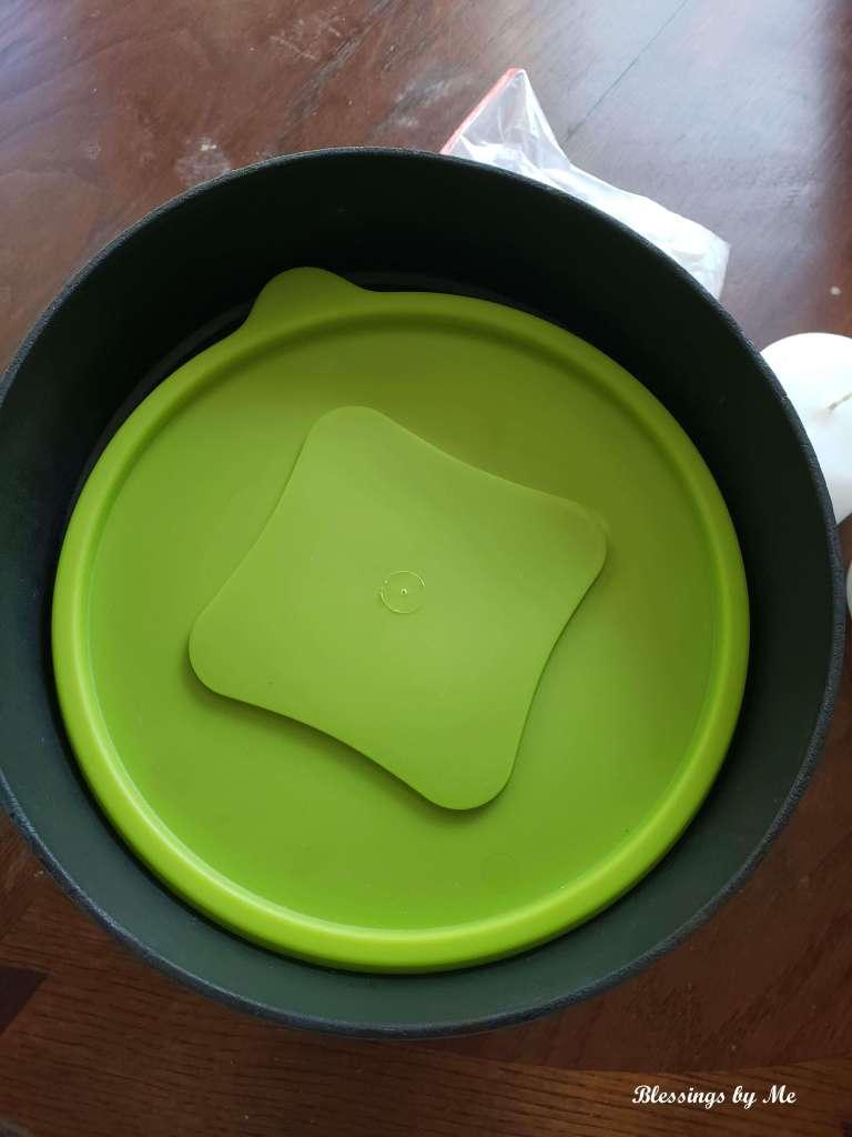 add a filler to the flower pot