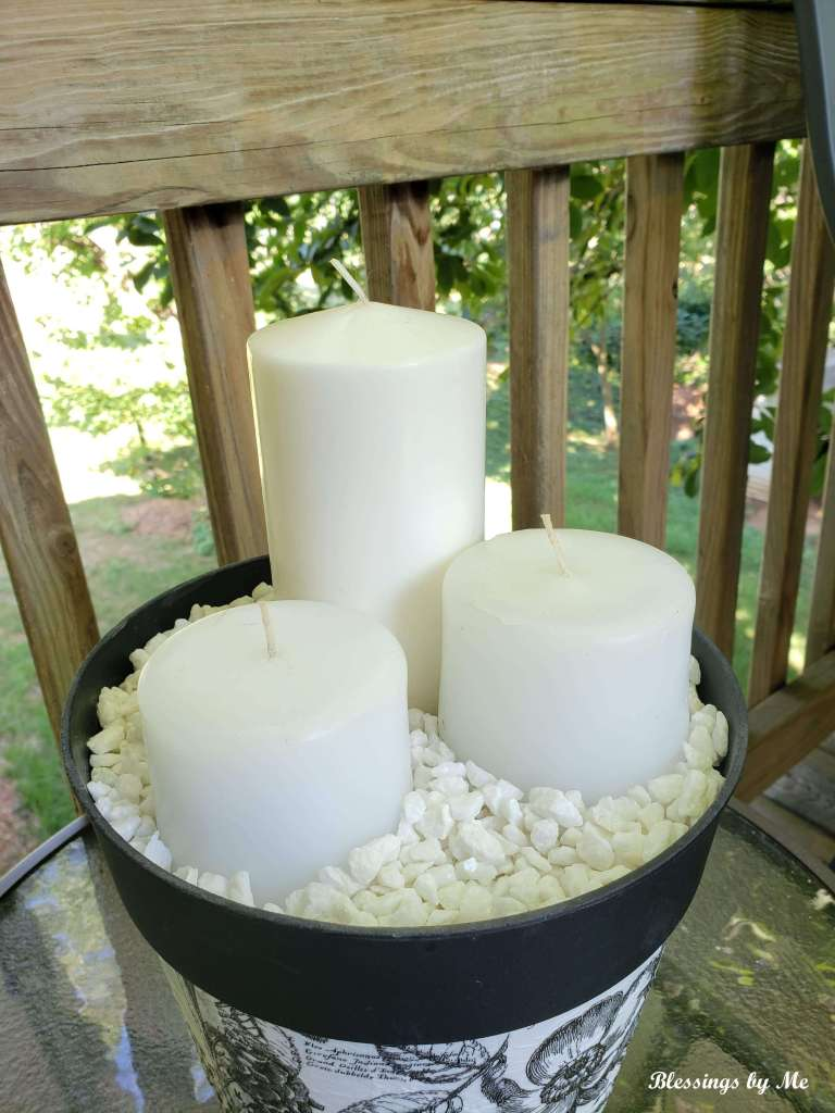 add candles to the repurposed flower pot
