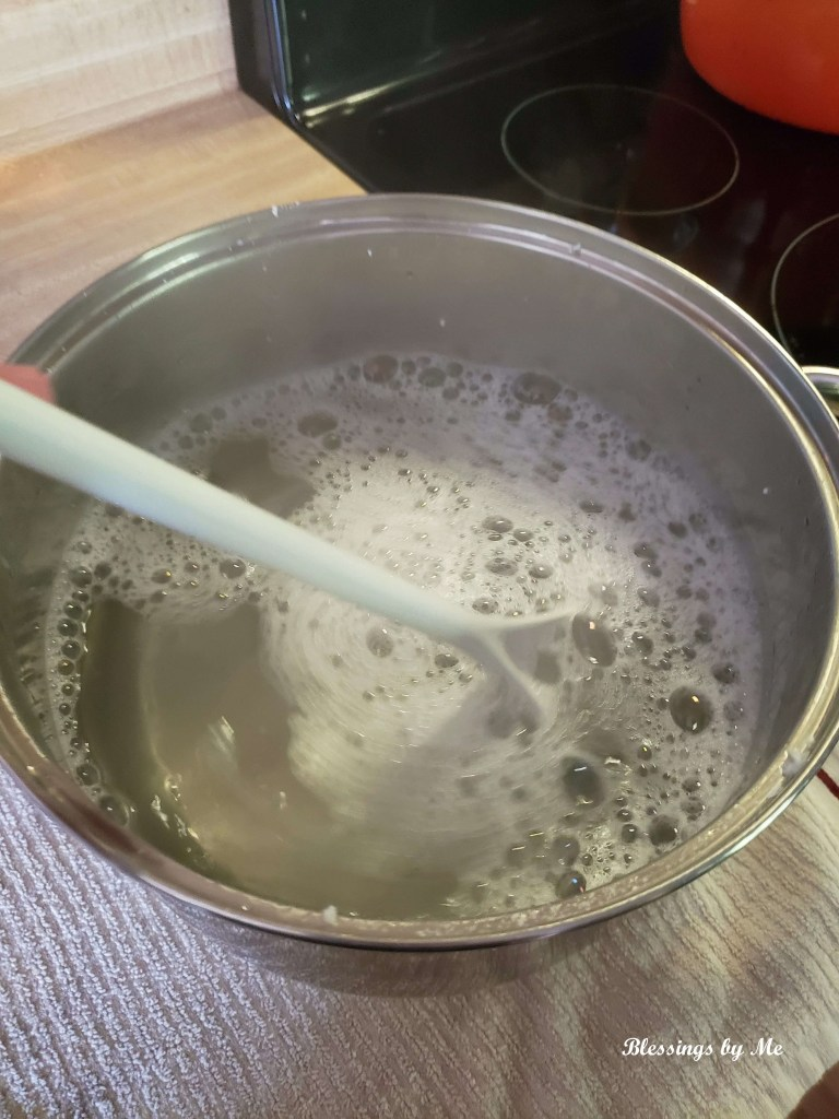 melt soap flakes in boiling water