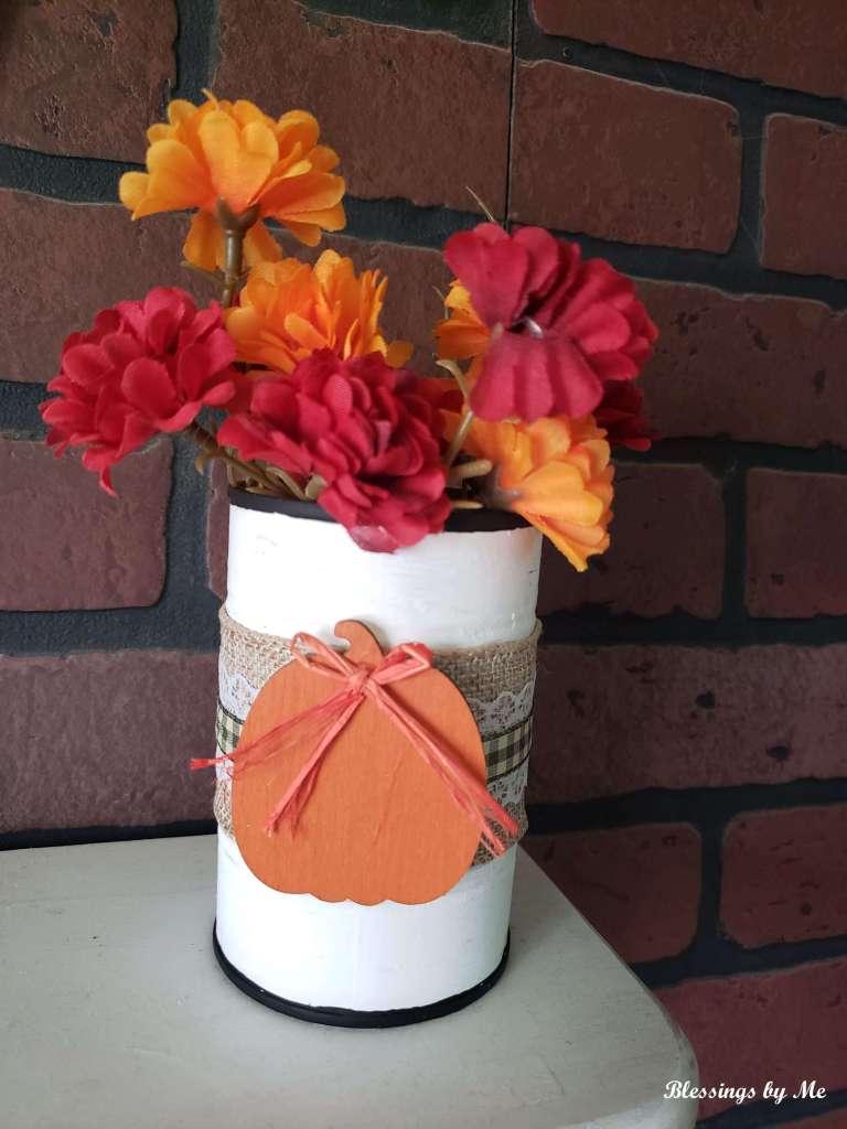 Add faux fall flowers