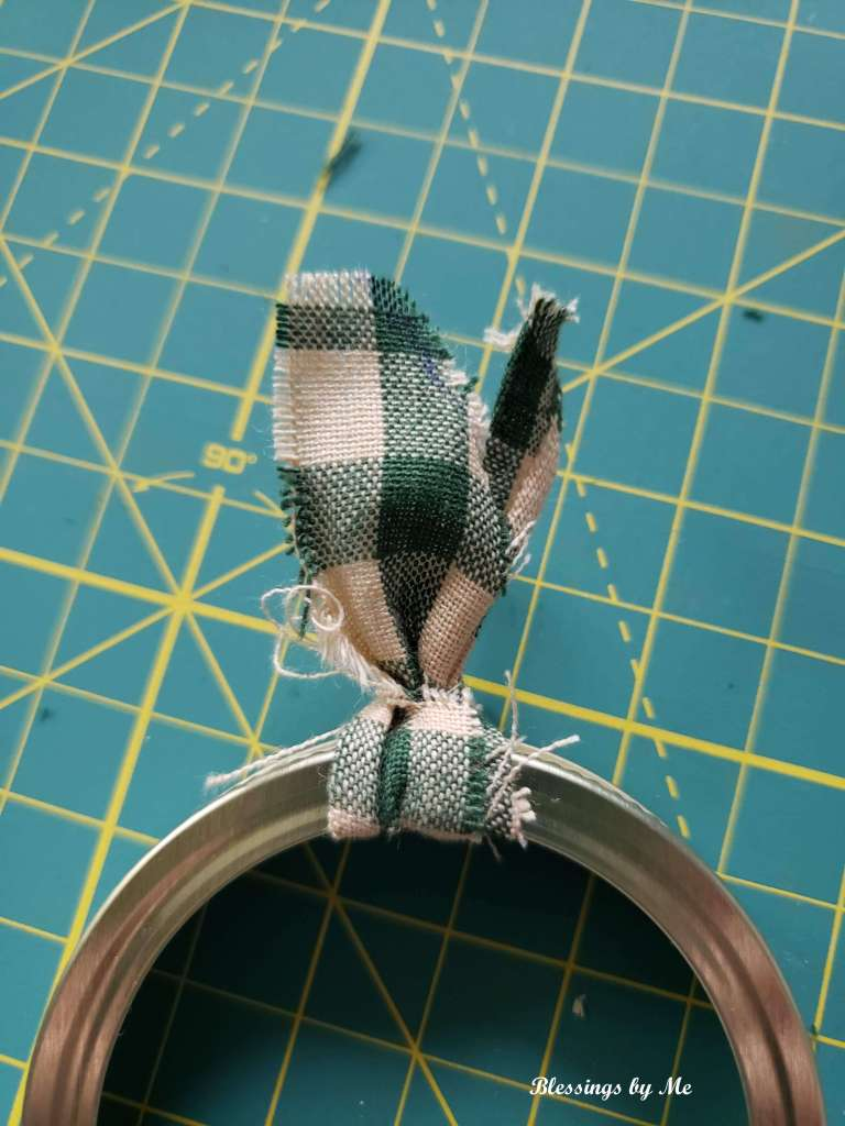 step 4 - tie the fabric strip into a knot on the ring