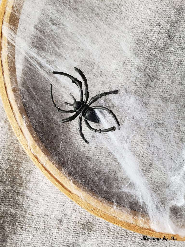 place spiders on the cobweb wreath