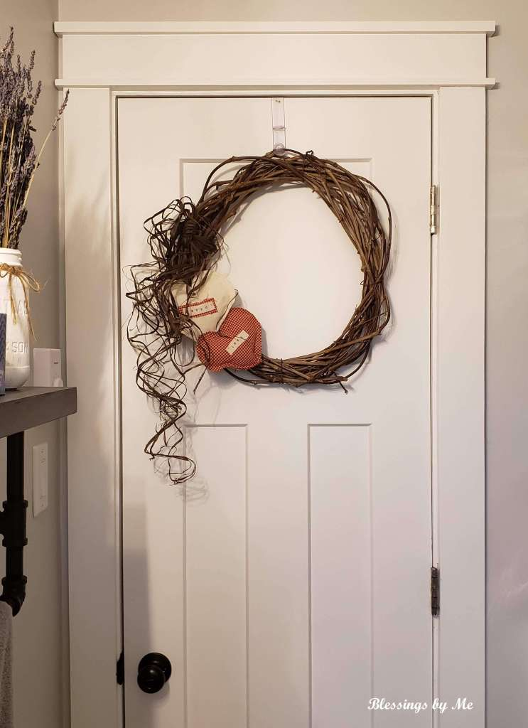 grapevine wreath on the bathroom door